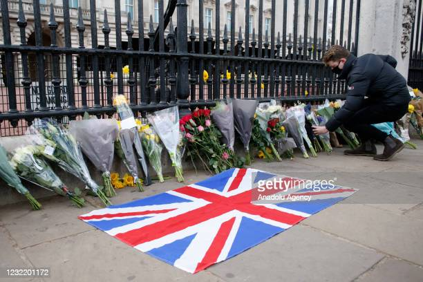 Man lays flowers of tribute for Britain's Prince Philip outside Buckingham Palace in London, United Kingdom on April 09, 2021. Buckingham Palace...