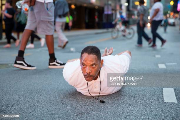 TOPSHOT A man lays on the ground after yelling Don't shoot me at police during a rally in Dallas Texas on Thursday July 7 2016 to protest the deaths...