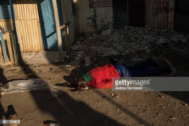 A man lays wounded on the ground after he was hit multiple times by a machete in the Kawangware slum on October 27 2017 in Nairobi Kenya Protests...