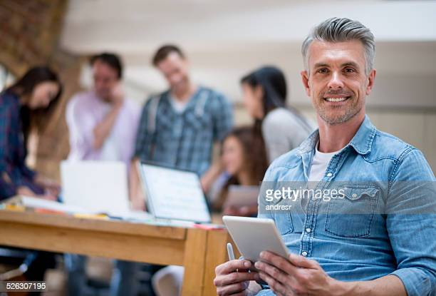 man leading a creative group - creative director stock pictures, royalty-free photos & images