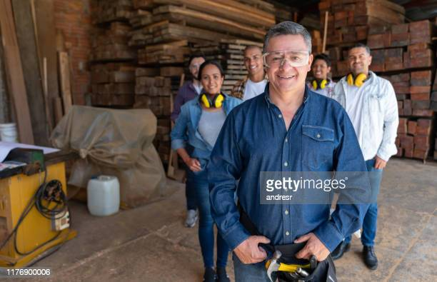 man leading a group of workers at a furniture store - pbs stock pictures, royalty-free photos & images