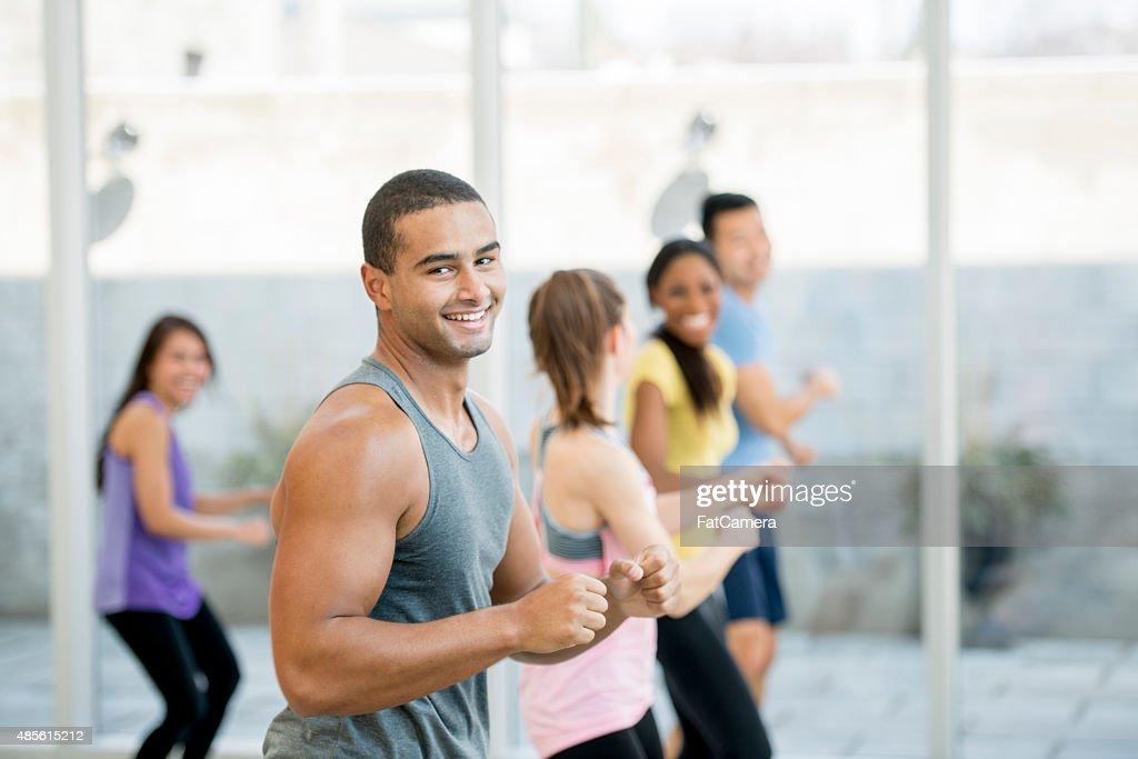 Man Leading Fitness Class : Stock Photo