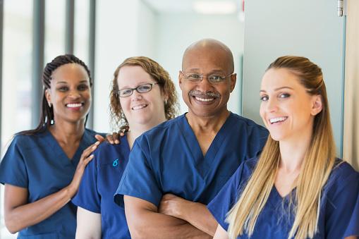 Man leading team of multi-ethnic medical professionals 844272122