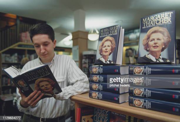 Man leafing through the autobiography of the Iron Lady.