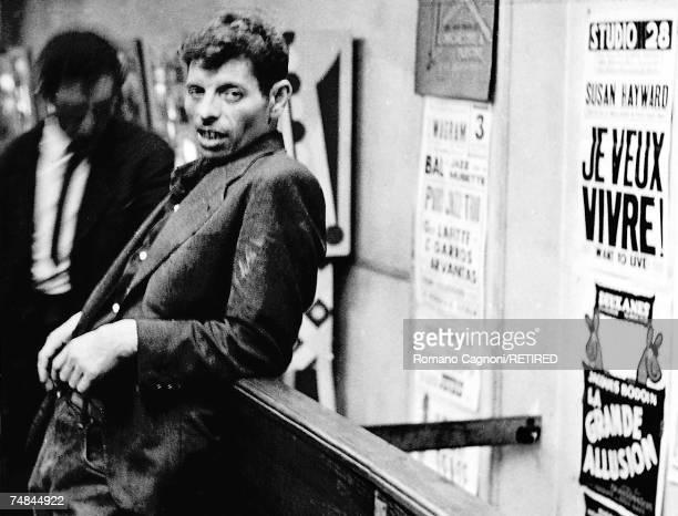 A man leaning against a bar Paris 1958