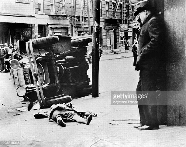 Man Leaning Against A Wall And Crying Before The Dead Body Of His Wife Who Was Killed In A Car Accident In The United States In 1935