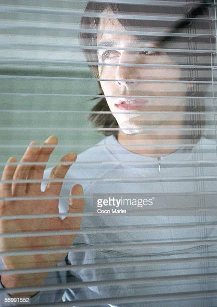 man leaning against window - doom patrol stock photos and pictures