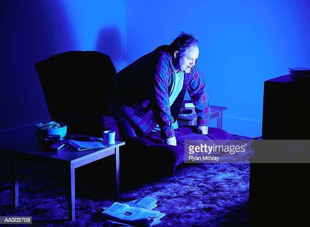 Man Leaning Into a Television