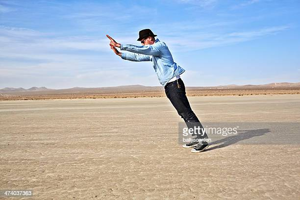man leaning into strong wind - leaning stock pictures, royalty-free photos & images