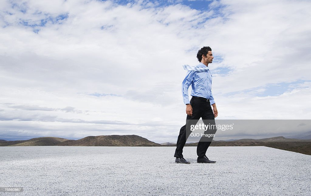 Man leaning into the wind : Stock Photo