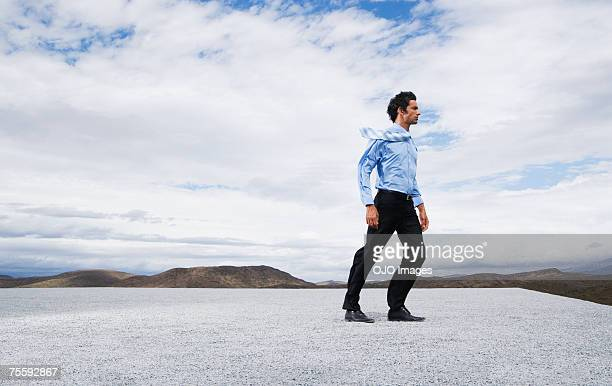 man leaning into the wind - leaning stock pictures, royalty-free photos & images