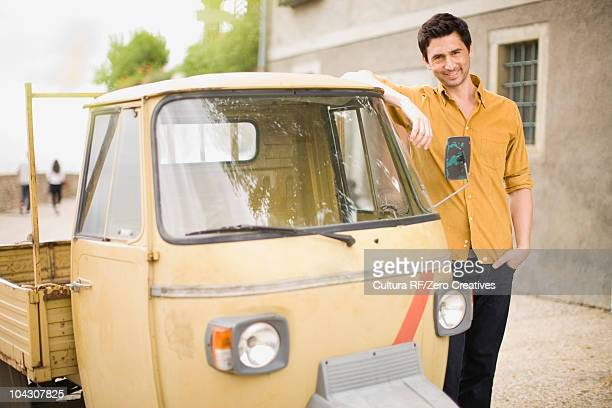 Man leaning on a piaggio Ape
