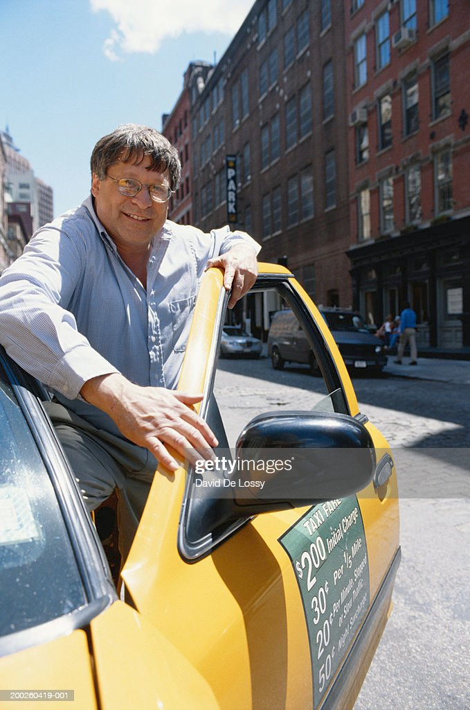 Man leaning on taxi door front view  Stock Photo & Man Leaning On Taxi Door Front View Stock Photo | Getty Images