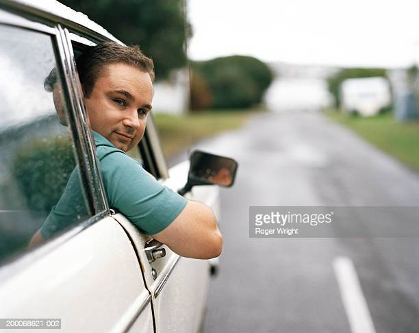 man leaning out of car window, portrait - looking over shoulder stock pictures, royalty-free photos & images