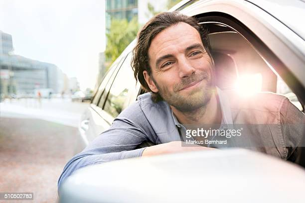 Man leaning out of his car window