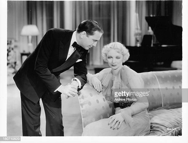 Man leaning over Virginia Bruce in a scene from the film 'The Garden Murder Case' 1936