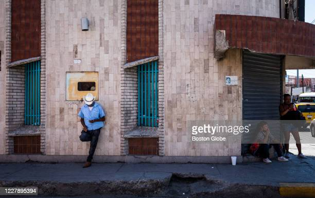 Man leans against a wall while wearing a cowboy hat in Juarez, Mexico on July 23, 2020. Bordering El Paso, Texas. Juarez, Mexico, has been at the...