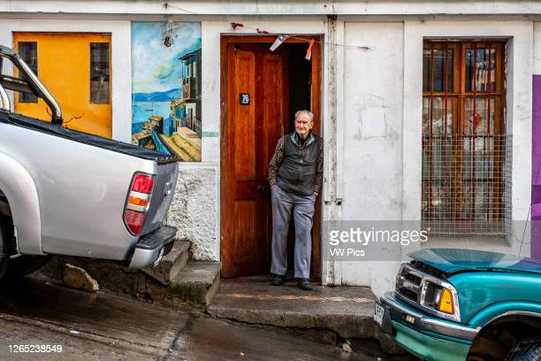 Man leans against his doorway, Valparaiso , Chile.