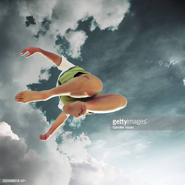 Man leaping through air, view from below