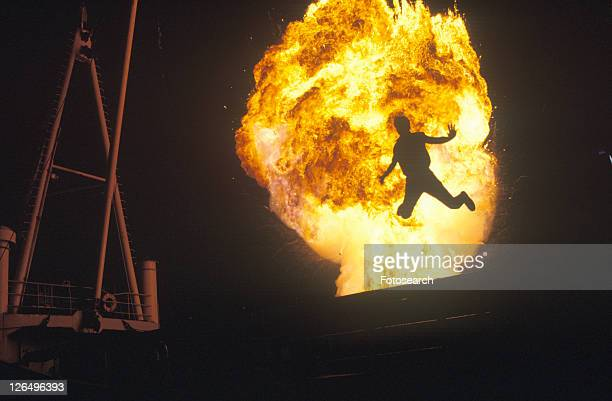 Man leaping through fireball