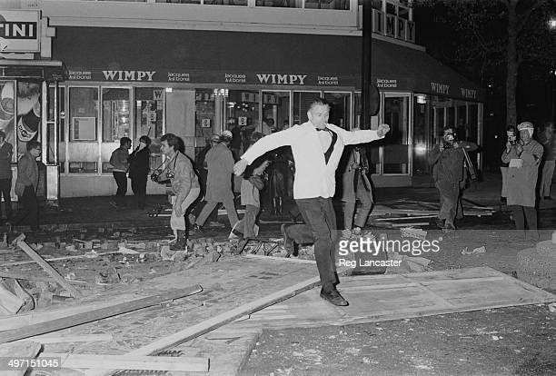 A man leaps over debris in the street during rioting near the Sorbonne in Paris 12th June 1968 Among the people behind him are four photographers