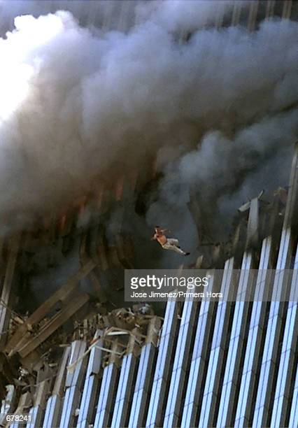 A man leaps to his death from a fire and smoke filled Tower One of the World Trade Center September 11 2001 in New York City after terrorists crashed...