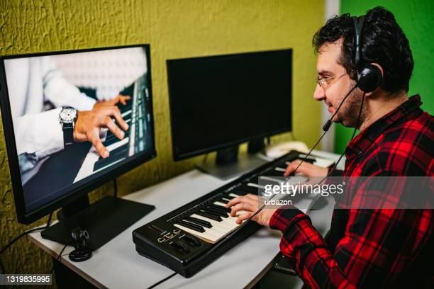 a man learning music online - audience free event stock pictures, royalty-free photos & images