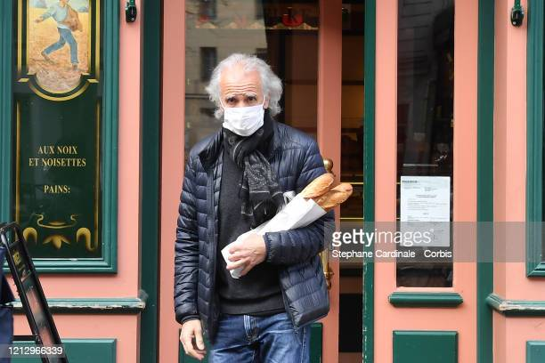 A man leaves a bakery wearing a face mask is seen while the city imposes emergency measures to combat the Coronavirus COVID19 outbreak on March 17...