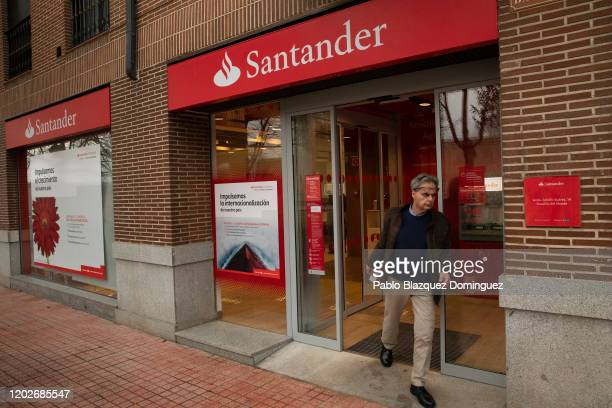 Man leaves a Banco Santander's branch before a news conference to announce the 2019 results on January 29, 2020 in Boadilla del Monte, in Madrid,...