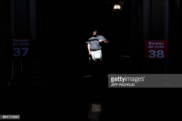 TOPSHOT A man leaves a polling station after voting during the first round of the French legislative elections in the Rhone department on June 11 in...
