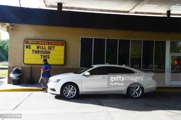 Man leaves a rural gas station near Savannah, Georgia, Sunday, 24 May 2020.