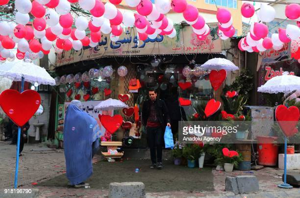 A man leaves a souvenir shop after shopping on Valentine's Day in Kabul Afghanistan on February 14 2018