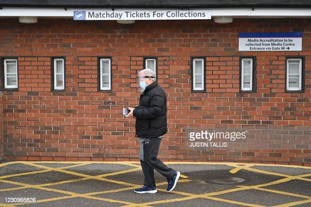 Man leaves after receiving a vaccination against Covid-19 at a temporary centre set up at Selhurst Park football stadium, the home of Crystal Palace...