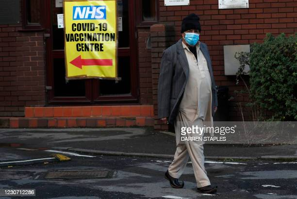 Man leaves after receiving the Oxford/AstraZeneca Covid-19 vaccine at the Al-Abbas Islamic Centre, which has been converted into a temporary...