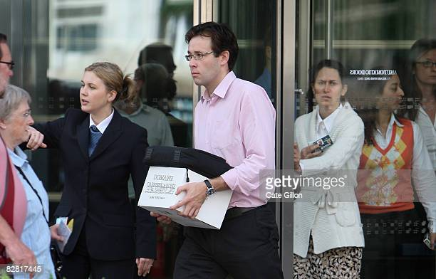 Man leaves Lehman Brothers' Canary Wharf office on September 15, 2008 in London, England. The fourth largest American investment bank has announced...
