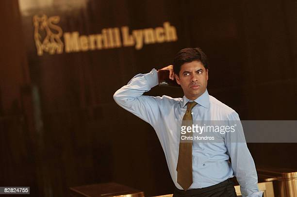 A man leaves Merrill Lynch's offices in the World Financial Center September 15 2008 in New York City Bank of America Corp the largest US consumer...