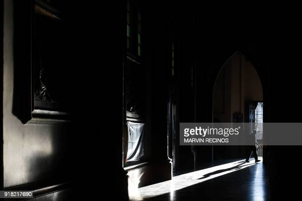 A man leaves the church during the celebration of Ash Wednesday in El Calvario parish in San Salvador on February 14 2018 Ash Wednesday marks the...