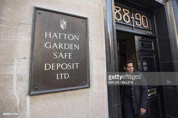 Man leaves the Hatton Garden Safe Deposit Limited on April 7, 2015 in London. Thieves have raided some 300 deposit boxes in London's diamond quarter,...