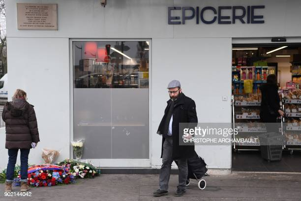 A man leaves the Hypercacher market in Porte de Vincenne in eastern Paris on January 7 three years after a French extremist took hostages at the...