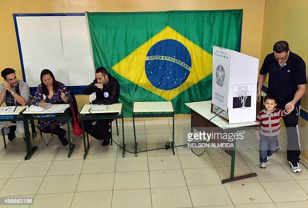 Man leaves the polling booth after casting his vote at a school in Sao Bernardo do Campo 25 km south of Sao Paulo on October 5, 2014. AFP PHOTO /...