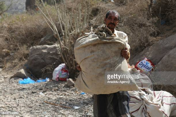 Man leaves the village with his belongings after Houthis captured Tubeysia village in Taiz province, Yemen on February 20, 2017.