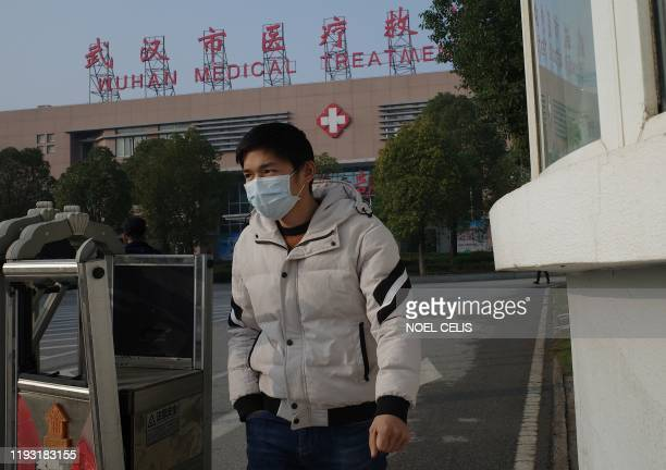 A man leaves the Wuhan Medical Treatment Centre where a man who died from a respiratory illness was confined in the city of Wuhan Hubei province on...