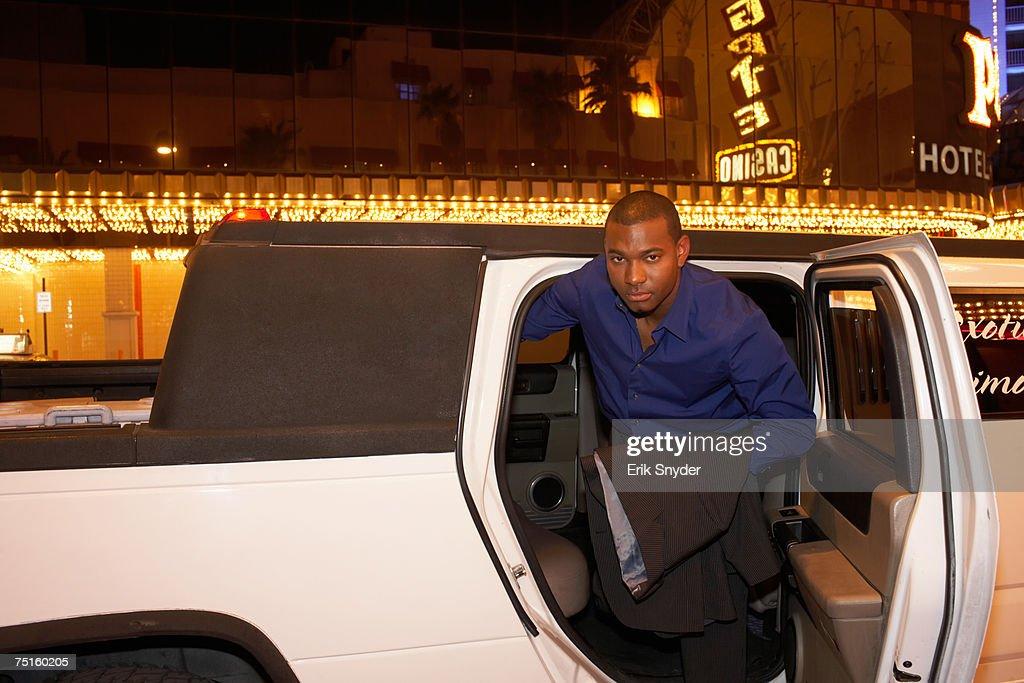 Man leaving limousine in front of casino, portrait : Bildbanksbilder