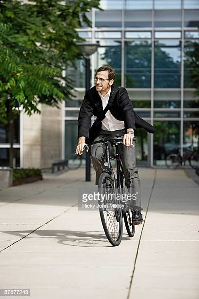 Man leaving the office on bicycle