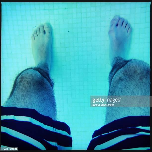 man legs in pool