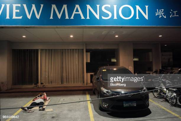 A man lies in the car park of a hotel at night in the Chinatown area of Manila the Philippines on Wednesday May 2 2018 Home prices in the...