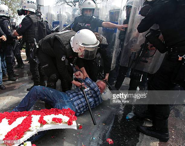 A man lies on the ground after Turkish police used a water cannon to disperse protestors during a May Day rally near Taksim Square in Istanbul on May...