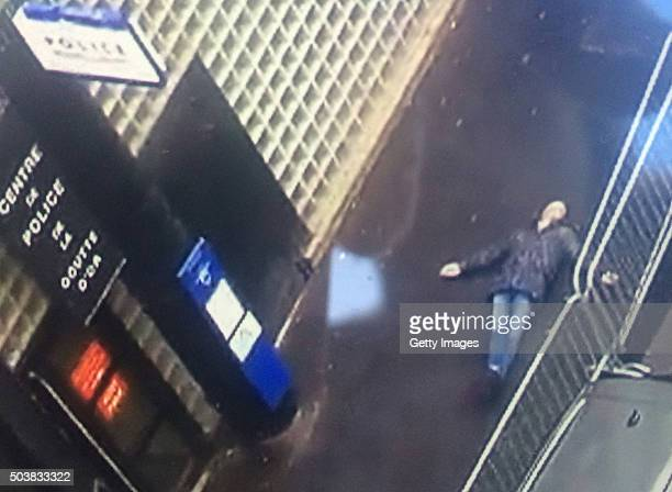A man lies outside a police station after being shot dead by police on January 7 2016 in Paris France French Police shot the man as he attempted to...