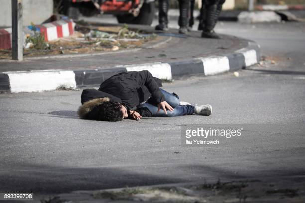 A man lies wounded after being shot by soldiers after he went on a stabbing attack in the area on December 15 2017 in Ramallah West Bank Reports say...