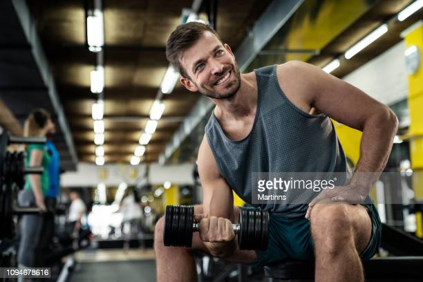 man lifting dumbbell - human arm stock pictures, royalty-free photos & images